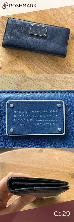 Marc by Marc Jacobs Wallet This wallet is well loved but still has some life left in it. Navy Blue with silver hardware Scuffs, scratches, stains and peeling of the leather in some spots (see photos). Price reflects condition. Marc By Marc Jacobs Bags Wallets Topshop Boutique, Marc Jacobs Wallet, Classic Trench Coat, Large Wallet, Black Patent Leather, Smooth Leather, Closets, Leather Wallet, Wallets