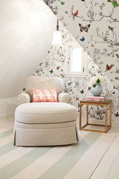 Snug little reading nook tucked under the eaves of a cheerful attic bedroom (Sarah Wittenbraker Interiors)
