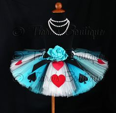 I'd love to make this alice in wonderland no sew tutu.  Loop tie tulle strips to measured elastic band and add felt shapes.