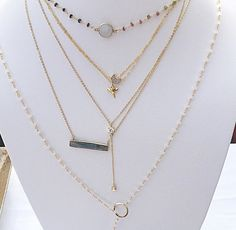 This delicate moon charm necklace is very small and delicate. The moon charm measures a 1/4 of an inch and has small cubic zirconias on the inside and sits on a