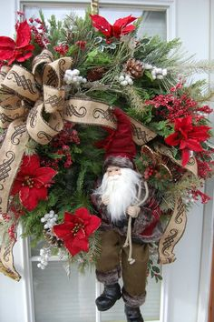 This is an exceptional Christmas wreath! Bring in the holidays with this designer wreath made from an artificial pine wreath. In this wreath I