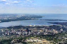 The City of Hamilton sits on the edge of Lake Ontario in Ontario, Canada. Burlington is just the other side of the bay, Toronto can be seen in the distance.