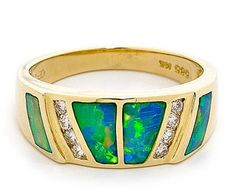 A splendid 14k Yellow Gold Solid Inlay Opal Ring is unique in its design and allure.Using Natural South Australian light crystal opals that are expertly cut, bonded and polished into the exquisite 14K yellow Gold setting, this stunning ring has 8 brilliant cut diamonds to provide contrast with the colourful opals and further enhance its appeal. Fantastic gift of the special someone! #opalsaustralia