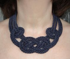Original design.This necklace was made from a silk rope. The ends of the rope securely fastened.The ends impregnated with glue, set on to the pin