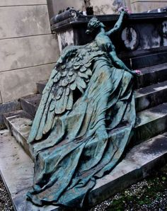 Winged feminine figure Bronze by sculptor Adolfo Apolloni 1904. Calcagno family burial monument at the Staglieno Cemetery, Genoa - Italy.
