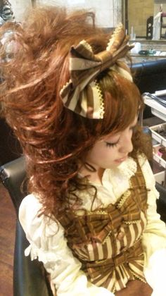 BIG HAIR! The gold colors are so classy. The stripes!!