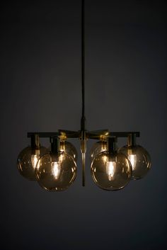 Hans-Agne Jakobsson Ceiling Lamp in Brass and Glass | From a unique collection of antique and modern chandeliers and pendants  at https://www.1stdibs.com/furniture/lighting/chandeliers-pendant-lights/