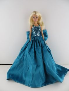 A Teal Green Satin Gown with Sequined Top Made to Fit the Barbie Doll Olivia's Doll Closet,http://www.amazon.com/dp/B00FQPFH4I/ref=cm_sw_r_pi_dp_koQHsb1WJHT0VJXX