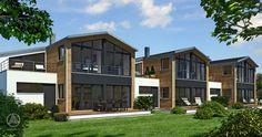 """Baufritz Mehrfamilienhaus Kettenhaus, die Garagen wirken zwischen den einzelnen Häusern wie einzelne Glieder. Von oben betrachtet wirken die Häuser daher wie ein """"Kettenhaus""""."""