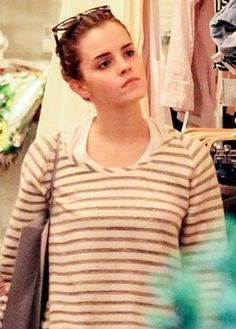 Emma Watson shopping solo at American Apparel in NYC, June 12