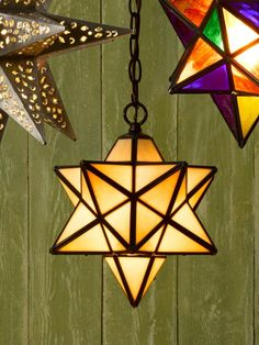 Black metal sets off this 12-point pendant's opalescent glass, which looks equally pretty when the light is turned off. From @wayfair