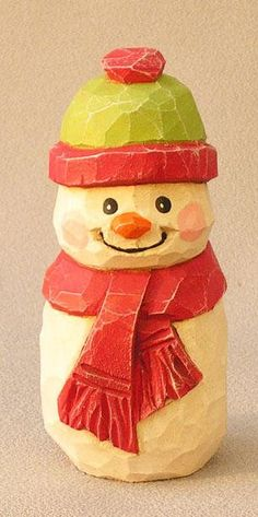 Wood Carving of a Snowman with red Green hat and red scarf