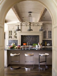 Gourmet Kitchen with beautiful beams and subtle color scheme. Rustic, but still light. Great back splash and light fixture.