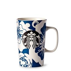 Brighten your day with a coffee mug blossoming with signs of spring. A grande ceramic coffee mug with a tropical flower design in white and blue.