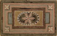"American hooked rug, 19th c. having a ceentral floral panel surrounded by a geometric border with x corner blocks, 20 3/4 "" x 33 1/4 "" sold for 1,067 dollars"