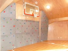 This home basketball court doubles as a rock climbing wall! How cool.