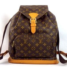 83fcd9dcf7c3 Brown Monogram Canvas Leather Backpack. Louis Vuitton ...