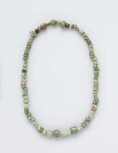 Beads, before 1519 Mesoamerica, Pre-Columbian polished green stone, Overall - l:63.00 cm (l:24 3/4 inches). Gift of Mr. and Mrs. James C. Gruener 1990.232