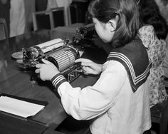 A new Japanese typewriter invented by Kotaro Kataoka, an employee of the Tokyo Electric Company, was demonstrated by a school student in Tokyo on August 31, 1949. The machine, smaller and lighter than the standard English language typewriter has the type cased on a cylindrical bed instead of the former Japanese flat bed in use. The new machine contains 1,132 characters in comparison to the old type which had 3000. (AP Photo/Charles Gorry) Ref #: PA.11669475