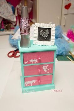 DIY American girl doll dresser. Wood dresser from Joann Painted with acrylic paint. I added vinyl images cut with the silhouette cameo.