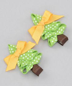 Take a look at this pink poseys bowtique green pine tree clip set on