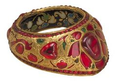 Archer's thumb ring, gold set with rubies and emeralds and enamelled, India or Pakistan, about 1600-1650, Museum no. IM. 207-1920