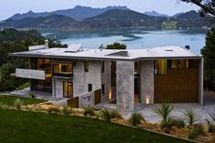 Interlocking concrete panels and bandsawn cedar wood express the structural composition of this country house