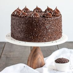 Chocolate Truffle Cake - a chocolate layer cake recipe with dense, moist chocolate cake, silky chocolate truffle frosting and chocolate flakes.