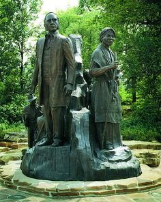 """Underground Railroad Sculpture - Battle Creek.  This area in Michigan was strong in the Underground Railroad, helping escaped slaves to their freedom in Canada.  Left is """"conductor"""" Erastus Hussey, right is Sojourner Truth."""