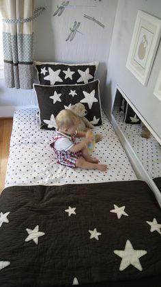 My Kid Sleeps on the Floor: Montessori Floor Bed - The Sprouting Seed. Floor bed, maybe. Like the mirror on its side Montessori Baby, Montessori Bedroom, Baby Bedroom, Kids Bedroom, Room Baby, Sleep On The Floor, Toddler Rooms, Kids Sleep, Baby Decor