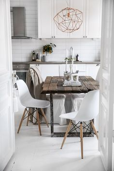Cool use of white and natural wood in this Scandinavian interior
