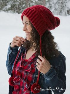 This slouchy bonnet is your answer for a cheery holiday fashion accessory! It's pleasantly slouched, has a nice big brim, and fluffy pom-poms.