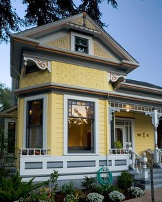 Yellow Victorian Cottage. A beautiful painted lady!