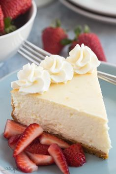 This Vanilla Cheesecake is super creamy and not as heavy as traditional baked cheesecake thanks to a good dose of sour cream or Greek yogurt -- it's soft and luscious and perfect with fresh berries!