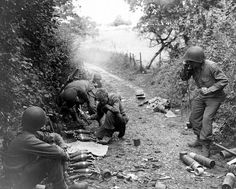 Mortar fire WWII Third Infantry Division soldiers are firing 81-mm mortar M1, somewhere in Italy. Corporal receives adjustment of fire by telephone.