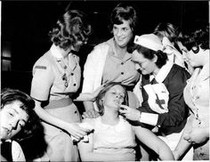 Beatlemania, Stockton on Tees, England 1963  © IAN WRIGHT, 1963  At Beatles shows, a St. Johns Ambulance nurse was always onhand to administer smelling salts to fainting fans.    The Globe Theatre, Stockton on Tees, England November 22, 1963