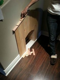"Shingle pieces were added to the top to give a real ""doghouse"" look. Building a cubby for dogs under the stairs!"