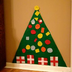 Felt Christmas tree with felt ornaments for child to play with instead of big tree. I cut the ornament into different shapes (circle, square, rectangle, triangle) to incorporate learning into a play! My 2 year old son loves his little tree and he loves naming the shapes and colors.
