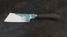 Blade engraved by Tom Inslay, handle in epoxy filled banksia.