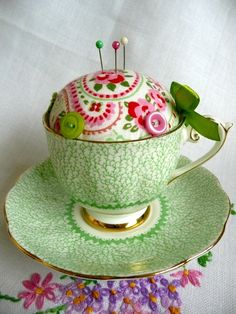 A great use for those cute little teacups and saucers found in thrift stores everywhere... Pin cushions!