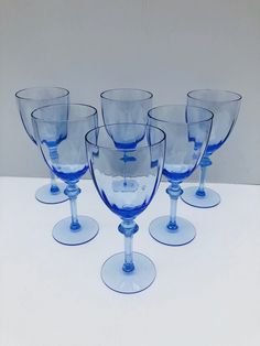Excited to share this item from my #etsy shop: Vintage Aqua Tinted Wine Glasses, Set of 5 (6 are photographed) Optic, Diamond Knobbed Stemware, Gorgeous, Rare, Wine Glasses #vintagewineglasses #diamondknob #vintagestemware #aquablueglasses #opticwineglasses #rarewineglasses #frenchcountry #countrycottage #vintageblue
