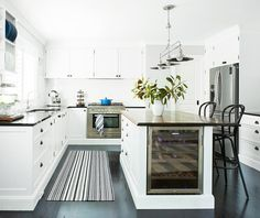 Hamptons-style white kitchen with plantation shutters. Too white for me