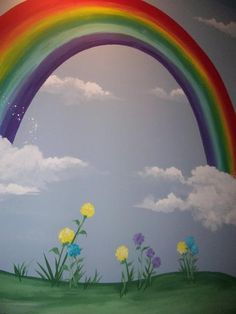 Rainbow mural and flowers on a playroom wall. I remember my mom doing this for…