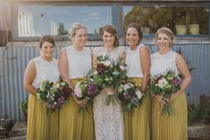 I love everything about this photo - the bride's dress, the mustard bridesmaid skirt/top combo and those lovely, wild, rustic bouquets!