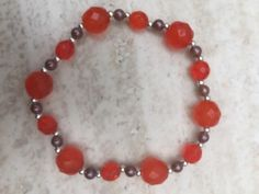 A personal favourite from my Etsy shop https://www.etsy.com/uk/listing/286547079/chunky-orange-faceted-bead-bracelet