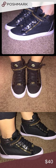 Guess high tops back and gold Guess high tops black and gold size 6, they are in great condition the bottom is a bit dirty all you have to do is clean them. G by Guess Shoes Sneakers