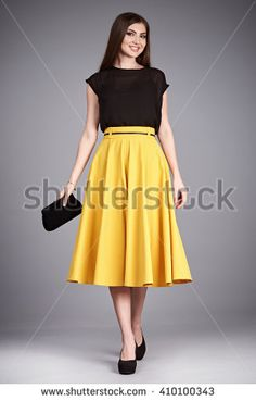 Beautiful sexy glamour woman lady long brunette hair makeup wear fashion clothes silk or cotton blouse trendy skirt lather shoes catalog in studio casual office clothes businesswoman accessory body bag