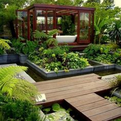 This is divine!  A lush garden bath area with Koi pond.