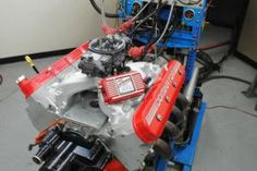 We grab an LQ4 LS truck engine from a junk yard, rebuild it, toss on a carburetor and made 464 hp on the engine dyno!