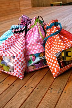 Peek-a-boo toy sacks. Great idea for small bits.